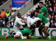 23 February 2020; Courtney Lawes of England is tackled by Peter O'Mahony and Bundee Aki of Ireland during the Guinness Six Nations Rugby Championship match between England and Ireland at Twickenham Stadium in London, England. Photo by Brendan Moran/Sportsfile