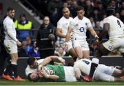 23 February 2020; Robbie Henshaw of Ireland dives over to score his side's second try despite the tackle of Ben Youngs of England during the Guinness Six Nations Rugby Championship match between England and Ireland at Twickenham Stadium in London, England. Photo by Ramsey Cardy/Sportsfile