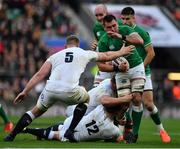 23 February 2020; CJ Stander of Ireland is tackled by Owen Farrell and George Kruis of England during the Guinness Six Nations Rugby Championship match between England and Ireland at Twickenham Stadium in London, England. Photo by Brendan Moran/Sportsfile
