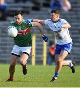 23 February 2020; Kevin McLoughlin of Mayo in action against Ryan Wylie of Monaghan during the Allianz Football League Division 1 Round 4 match between Monaghan and Mayo at St Tiernach's Park in Clones, Monaghan. Photo by Oliver McVeigh/Sportsfile