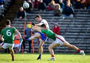 23 February 2020; Conor McManus of Monaghan in action against Oisin Mullin of Mayo during the Allianz Football League Division 1 Round 4 match between Monaghan and Mayo at St Tiernach's Park in Clones, Monaghan. Photo by Oliver McVeigh/Sportsfile