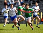 23 February 2020; Conor Boyle of Monaghan in action against Ryan O'Donoghue of Mayo during the Allianz Football League Division 1 Round 4 match between Monaghan and Mayo at St Tiernach's Park in Clones, Monaghan. Photo by Oliver McVeigh/Sportsfile