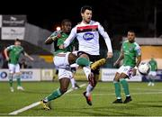 24 February 2020; Joseph Olowu of Cork City in action against Patrick Hoban during the SSE Airtricity League Premier Division match between Dundalk and Cork City at Oriel Park in Dundalk, Louth. Photo by Seb Daly/Sportsfile
