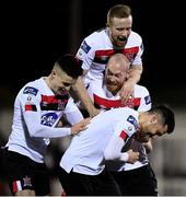 24 February 2020; Jordan Flores of Dundalk, bottom, celebrates with team-mates, from left, Darragh Leahy, Chris Shields and Sean Hoare after scoring his side's third goal during the SSE Airtricity League Premier Division match between Dundalk and Cork City at Oriel Park in Dundalk, Louth. Photo by Seb Daly/Sportsfile