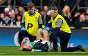 23 February 2020; Jordan Larmour of Ireland is attended to by team doctor Dr Ciaran Cosgrave and team physio Colm Fuller during the Guinness Six Nations Rugby Championship match between England and Ireland at Twickenham Stadium in London, England. Photo by Brendan Moran/Sportsfile