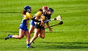23 February 2020; Aoife Doyle of Kilkenny is tackled by Ciara Grogan and Alannah Ryan of Clare during the Littlewoods Ireland Camogie League Division 1 match between Kilkenny and Clare at UPMC Nowlan Park in Kilkenny. Photo by Ray McManus/Sportsfile