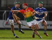 22 February 2020; Michael Malone of Carlow in action against James Ryan and Ross King of  Laois during the Allianz Hurling League Division 1 Group B Round 4 match between Laois and Carlow at MW Hire O'Moore Park in Portlaoise, Laois. Photo by Matt Browne/Sportsfile