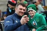 28 February 2020; Peter O'Mahony takes a selfie with a young supporter following an Ireland Rugby open training session at Energia Park in Donnybrook, Dublin. Photo by Ramsey Cardy/Sportsfile