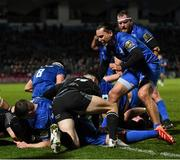 28 February 2020; Scott Fardy, hidden, celebrates with Leinster team-mates, including Luke McGrath and James Lowe after scoring his side's third try during the Guinness PRO14 Round 13 match between Leinster and Glasgow Warriors at the RDS Arena in Dublin. Photo by Ramsey Cardy/Sportsfile