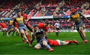 29 February 2020; Angus O'Brien of Scarlets is tackled by Chris Cloete, left, and Craig Casey of Munster during the Guinness PRO14 Round 13 match between Munster and Scarlets at Thomond Park in Limerick. Photo by Ramsey Cardy/Sportsfile