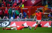 29 February 2020; JJ Hanrahan of Munster kicks a conversion, assisted by Craig Casey, during the Guinness PRO14 Round 13 match between Munster and Scarlets at Thomond Park in Limerick. Photo by Ramsey Cardy/Sportsfile