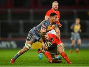 29 February 2020; Craig Casey of Munster is tackled by Dan Davis of Scarlets during the Guinness PRO14 Round 13 match between Munster and Scarlets at Thomond Park in Limerick. Photo by Ramsey Cardy/Sportsfile