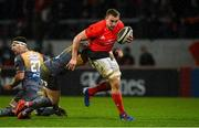 29 February 2020; Tommy O'Donnell of Munster is tackled by Steffan Hughes of Scarlets during the Guinness PRO14 Round 13 match between Munster and Scarlets at Thomond Park in Limerick. Photo by Diarmuid Greene/Sportsfile