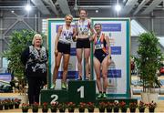 29 February 2020; Athletics Ireland President Georgina Drumm, left, with Senior Women's 3000m medallists, from left, Niamh Allen of Crusaders AC, Dublin, silver, Ciara Wilson of DMP AC, Wexford, gold, and Niamh Kearney of Sli Cualann AC, Wicklow, bronze, competing in the event during day one of the Irish Life Health National Senior Indoor Athletics Championships at the National Indoor Arena in Abbotstown in Dublin. Photo by Sam Barnes/Sportsfile