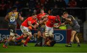 29 February 2020; John Hodnett of Munster is tackled by Jonathan Evans, Lewis Rawlins and Ifan Phillips of Scarlets during the Guinness PRO14 Round 13 match between Munster and Scarlets at Thomond Park in Limerick. Photo by Diarmuid Greene/Sportsfile