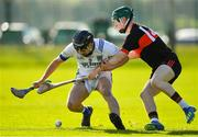 1 March 2020; Jarlath Collins of St Flannan's Ennis in action against Jack Cahalane of CBC Cork during the Munster GAA Dr. Harty Cup Final match between CBC Cork and St Flannan's Ennis at Mallow GAA Complex in Cork. Photo by Seb Daly/Sportsfile