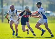 1 March 2020; Daire Burke of CBC Cork in action against Tony Butler, left, and Jarlath Collins of St Flannan's Ennis during the Munster GAA Dr. Harty Cup Final match between CBC Cork and St Flannan's Ennis at Mallow GAA Complex in Cork. Photo by Seb Daly/Sportsfile