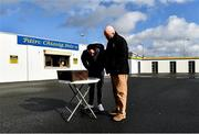 1 March 2020; Munster Council's Operations manager John Brennan and Clare PRO Michael O'Connor, right, watch a broadcast of the Dr. Harty Cup Final, on a smartphone, before the Allianz Hurling League Division 1 Group B Round 5 match between Clare and Dublin at Cusack Park in Ennis, Clare. Photo by Ray McManus/Sportsfile