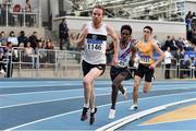 1 March 2020; John Travers of Donore Harriers, Dublin, on his way to winning the Senior Men's 3000m event, ahead of Hiko Haso Tonosa of Dundrum South Dublin AC, who finished second, centre, and Darragh McElhinney of UCD AC, Dublin, during Day Two of the Irish Life Health National Senior Indoor Athletics Championships at the National Indoor Arena in Abbotstown in Dublin. Photo by Sam Barnes/Sportsfile