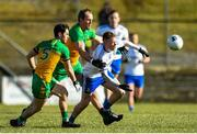 1 March 2020; Ryan McAnespie of Monaghan in action against Ryan McHugh and Michael Murphy of Donegal during the Allianz Football League Division 1 Round 5 match between Donegal and Monaghan at Fr. Tierney Park in Ballyshannon, Donegal. Photo by Oliver McVeigh/Sportsfile