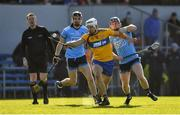 1 March 2020; Referee David Hughes looks on as Aron Shanagher of Clare is tackled by David Keogh of Dublin, right, during the Allianz Hurling League Division 1 Group B Round 5 match between Clare and Dublin at Cusack Park in Ennis, Clare. Photo by Ray McManus/Sportsfile