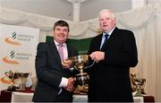 2 March 2020; Neil Martin of Finn Valley AC is presented the John Smyth Cup by Chairperson of the Athletics Ireland Juvenile Committee John McGrath during the Juvenile Star Awards 2019 at The Bridge Hotel in Tullamore, Offaly. Photo by Harry Murphy/Sportsfile
