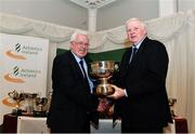 2 March 2020; Mossie Woulfe of Munster is presented the McGuiness Cup by Chairperson of the Athletics Ireland Juvenile Committee John McGrath during the Juvenile Star Awards 2019 at The Bridge Hotel in Tullamore, Offaly. Photo by Harry Murphy/Sportsfile
