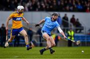 1 March 2020; Mark Schutte of Dublin and Jack Browne of Clare race for the sliotar during the Allianz Hurling League Division 1 Group B Round 5 match between Clare and Dublin at Cusack Park in Ennis, Clare. Photo by Ray McManus/Sportsfile