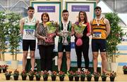 1 March 2020;  Dean Adams of Ballymena and Antrim AC is presented with the Craig Lynch cup by Craig's mother Anne Lynch, second from left, and fiancé Amy Cotter, second from right, after winning the Senior Men's 60m event during Day Two of the Irish Life Health National Senior Indoor Athletics Championships at the National Indoor Arena in Abbotstown in Dublin. Also pictured are medallists, Mark Smyth of Raheny Shamrock AC, Dublin, silver, left, and Conor Morey of Leevale AC, Cork.  Photo by Sam Barnes/Sportsfile