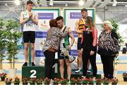 1 March 2020;  Dean Adams of Ballymena and Antrim AC is presented with the Craig Lynch cup by Craig's mother Anne Lynch, second from left, and fiancé Amy Cotter, second from right, after winning the Senior Men's 60m event during Day Two of the Irish Life Health National Senior Indoor Athletics Championships at the National Indoor Arena in Abbotstown in Dublin. Also pictured are medallists, Mark Smyth of Raheny Shamrock AC, Dublin, silver, left, Conor Morey of Leevale AC, Cork, and Athletics Ireland President Georgina Drumm. Photo by Sam Barnes/Sportsfile