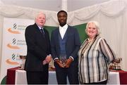 2 March 2020; Charles Okafor of Mullingar Harriers AC, Westmeath, is presented his Star Award trophy by Chairperson of the Athletics Ireland Juvenile Committee John McGrath and President of Athletics Ireland Georgina Drumm during the Juvenile Star Awards 2019 at The Bridge Hotel in Tullamore, Offaly. Photo by Harry Murphy/Sportsfile