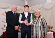 2 March 2020; Conor Hoade of Galway City Harriers is presented his Star Award trophy by Chairperson of the Athletics Ireland Juvenile Committee John McGrath and President of Athletics Ireland Georgina Drumm during the Juvenile Star Awards 2019 at The Bridge Hotel in Tullamore, Offaly. Photo by Harry Murphy/Sportsfile