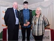 2 March 2020; Odhran Hamilton of Armagh AC, Armagh, is presented his Star Award trophy by Chairperson of the Athletics Ireland Juvenile Committee John McGrath and President of Athletics Ireland Georgina Drumm during the Juvenile Star Awards 2019 at The Bridge Hotel in Tullamore, Offaly. Photo by Harry Murphy/Sportsfile