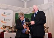 2 March 2020; Gerry Hayes of Ennis Track AC, Clare, is presented the Kennedy Cup by Chairperson of the Athletics Ireland Juvenile Committee John McGrath during the Juvenile Star Awards 2019 at The Bridge Hotel in Tullamore, Offaly. Photo by Harry Murphy/Sportsfile