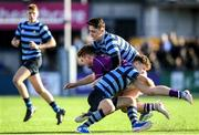 2 March 2020; Chris Grimes of Clongowes Wood College is tackled by Louis McDonough and Conor Delaney of St Vincent's, Castleknock College, during the Bank of Ireland Leinster Schools Senior Cup Semi-Final between Clongowes Wood College and St Vincent's, Castleknock College, at Energia Park in Donnybrook, Dublin. Photo by Ramsey Cardy/Sportsfile