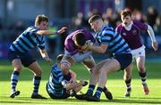 2 March 2020; Diarmuid McCormack of Clongowes Wood College is tackled by Conor Duggan, left, and Fionn Gibbons of St Vincent's, Castleknock College, during the Bank of Ireland Leinster Schools Senior Cup Semi-Final between Clongowes Wood College and St Vincent's, Castleknock College, at Energia Park in Donnybrook, Dublin. Photo by Ramsey Cardy/Sportsfile