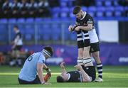 3 March 2020; Diarmuid Mangan is treated for cramp by Newbridge College team-mate Sam Cahill during the Bank of Ireland Leinster Schools Senior Cup Semi-Final match between St Michael's College and Newbridge College at Energia Park in Donnybrook, Dublin. Photo by Ramsey Cardy/Sportsfile