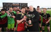 3 March 2020; CFAI Chairman Joe O'Brien presents the trophy to IT Carlow captain Jason Murphy and his team-mates following the Rustlers CFAI Cup Final match between IT Sligo and IT Carlow at Athlone Town Stadium in Athlone, Co Westmeath. Photo by Stephen McCarthy/Sportsfile