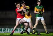 4 March 2020; Kerry goalkeeper Marc Kelliher, supported by team-mate James McCarthy, right, is tackled by Fionn Herlihy of Cork during the EirGrid Munster GAA Football U20 Championship Final match between Kerry and Cork at Austin Stack Park in Tralee, Kerry. Photo by Piaras Ó Mídheach/Sportsfile