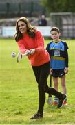 5 March 2020; Catherine, Duchess of Cambridge makes an attempt to hit a sliothar with a hurley during an engagement at Salthill Knocknacarra GAA Club in Galway during day three of her visit to Ireland. Photo by Sam Barnes/Sportsfile