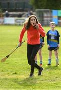 5 March 2020; Catherine, Duchess of Cambridge reacts after making an attempt to hit a sliothar with a hurley during an engagement at Salthill Knocknacarra GAA Club in Galway during day three of her visit to Ireland. Photo by Sam Barnes/Sportsfile