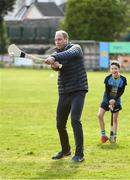 5 March 2020; Prince William, Duke of Cambridge makes an attempt to hit a sliothar with a hurley during an engagement at Salthill Knocknacarra GAA Club in Galway during day three of his visit to Ireland. Photo by Sam Barnes/Sportsfile