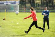 5 March 2020; Catherine, Duchess of Cambridge makes an attempt at a hand pass during an engagement at Salthill Knocknacarra GAA Club in Galway during day three of her visit to Ireland. Photo by Sam Barnes/Sportsfile
