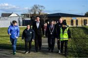 6 March 2020; FAI Interim Deputy Chief Executive Niall Quinn accompanied by Lord Mayor of Dublin Tom Brabazon and Jimmy Mowlds, FAI Development Officer, make their way to the opening of the new Darndale FC all-weather pitch at Darndale Park in Dublin. Photo by Stephen McCarthy/Sportsfile