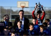 6 March 2020; FAI Interim Deputy Chief Executive Niall Quinn and Lord Mayor of Dublin Tom Brabazon pose for a photograph with Darndale FC players as Thomas Daly of Darndale FC introduces 'The FA Cup' after preforming the official opening of the new Darndale FC all-weather pitch at Darndale Park in Dublin. Photo by Stephen McCarthy/Sportsfile
