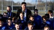 6 March 2020; FAI Interim Deputy Chief Executive Niall Quinn and Lord Mayor of Dublin Tom Brabazon pose for a photograph with Darndale FC players after preforming the official opening of the new Darndale FC all-weather pitch at Darndale Park in Dublin. Photo by Stephen McCarthy/Sportsfile