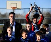 6 March 2020; FAI Interim Deputy Chief Executive Niall Quinn poses for a photograph with Darndale FC players as Thomas Daly of Darndale FC introduces 'The FA Cup' after preforming the official opening of the new Darndale FC all-weather pitch at Darndale Park in Dublin. Photo by Stephen McCarthy/Sportsfile