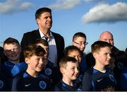 6 March 2020; FAI Interim Deputy Chief Executive Niall Quinn poses for a photograph with Darndale FC players after preforming the official opening of the new Darndale FC all-weather pitch at Darndale Park in Dublin. Photo by Stephen McCarthy/Sportsfile