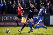 6 March 2020; Daniel Cleary of Dundalk is tackled by Kosovar Sadiki of Finn Harps during the SSE Airtricity League Premier Division match between Finn Harps and Dundalk at Finn Park in Ballybofey, Donegal. Photo by Ben McShane/Sportsfile