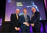 6 March 2020; Paul Devlin of Kilcoo is presented with his Football Team of the Year Award by AIB Head of Retail Banking Denis O'Callaghan, left, and Uachtarán Chumann Lúthchleas Gael John Horan during the AIB GAA Club Players' Awards at Croke Park in Dublin. Photo by Ramsey Cardy/Sportsfile